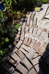 The stones and meandering bricks create a lovely sense of movement.