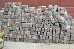 Aproximately 1400 bricks waiting to become a pathway in the Secret Garden.