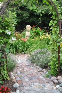 Day lilies, white clematis, Jean Davis lavender greeting everyone at the entrance to the Secret Garden.