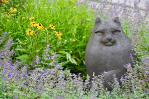 What more could you want: A cat statue, Rudbekia, and Walker's Low Catmint in the entrance garden.